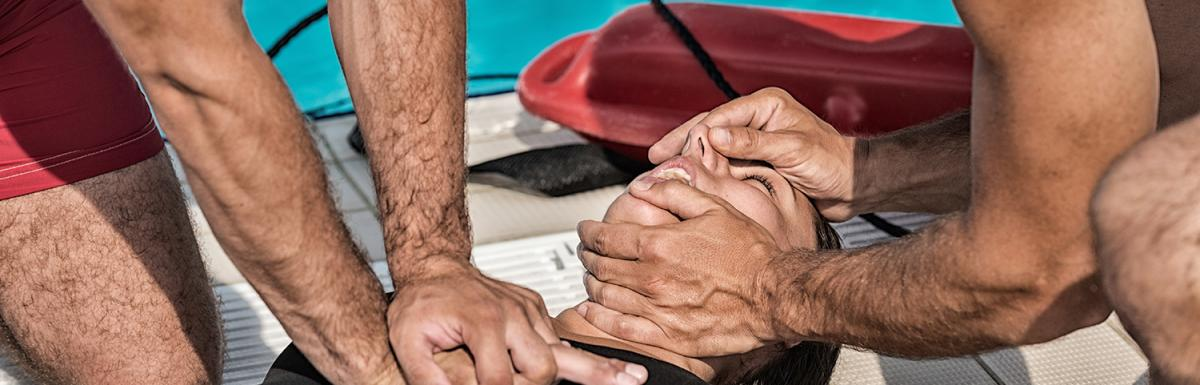 Two Lifeguards Work to Resuscitate a Woman