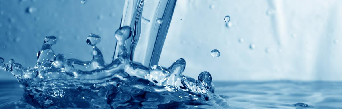 Water Splashing on Blue Background