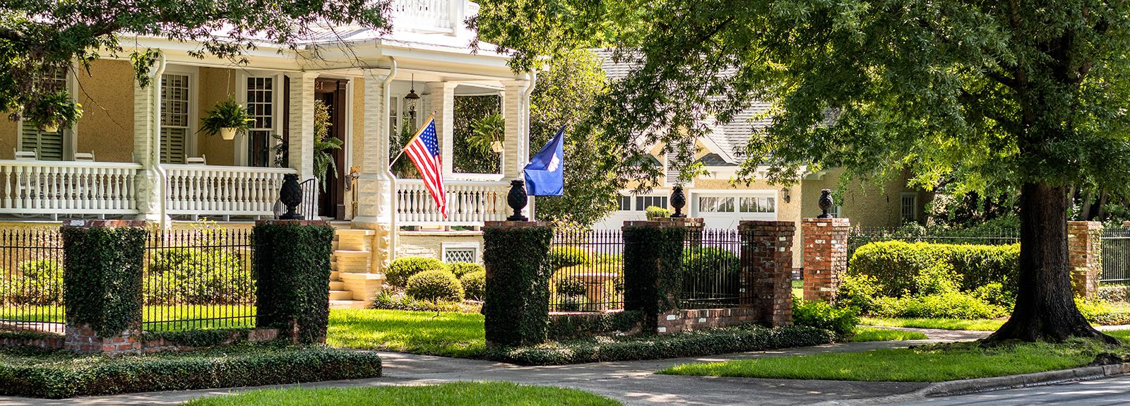 An historic home on Calhoun Street in Downtown Sumter proudly displays the South Carolina and US Flags